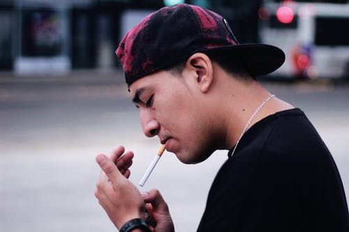 Close-Up Photo of Person Lighting A Cigarette