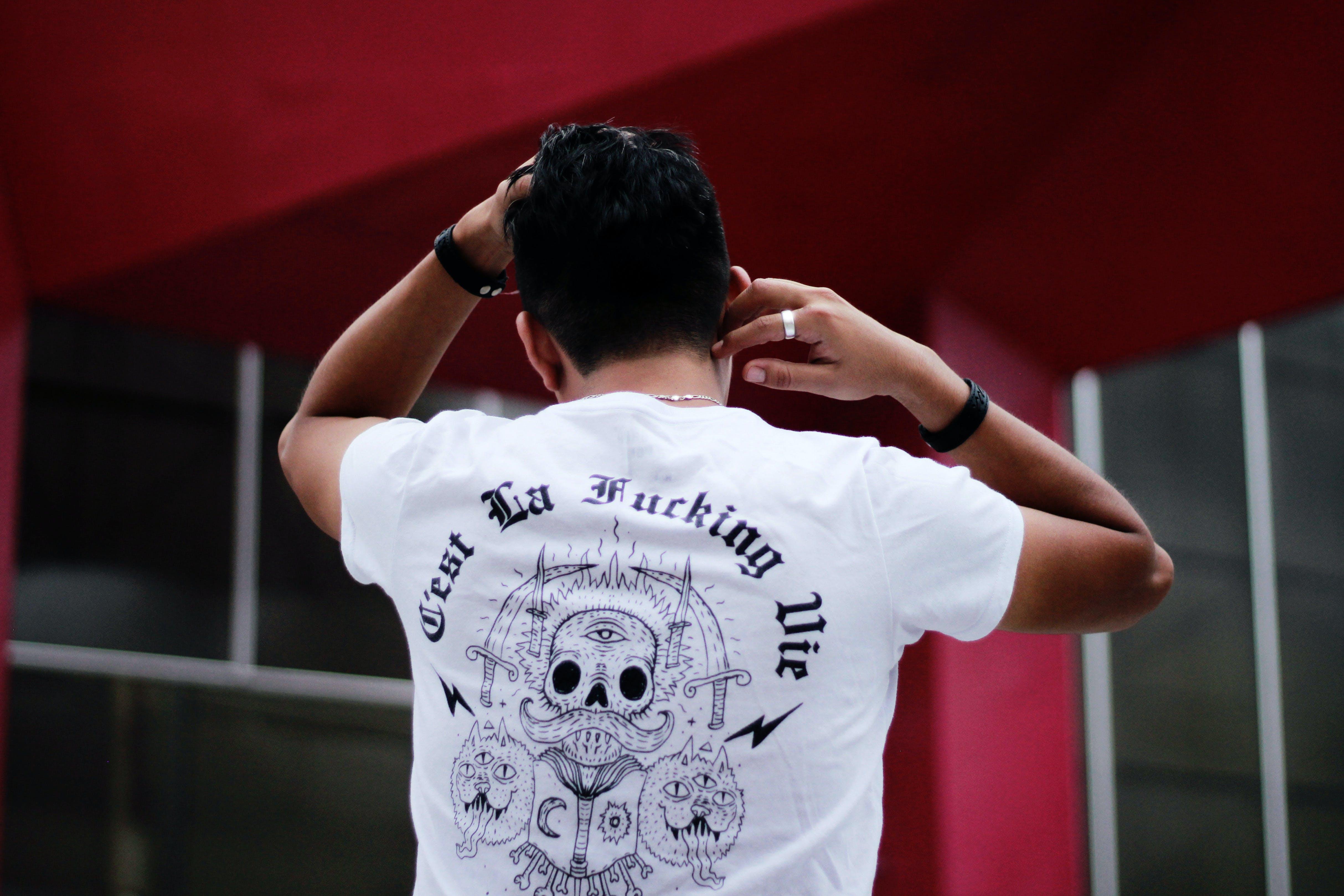 Man Turning Back Showing White T-shirt