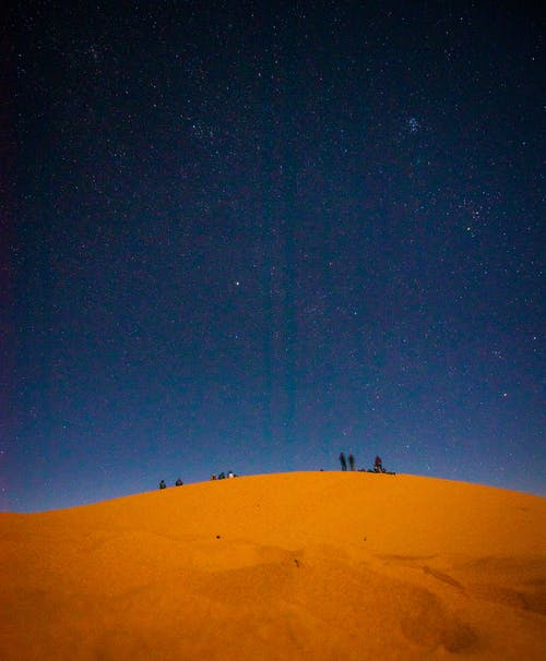 People At The Desert At Night Time