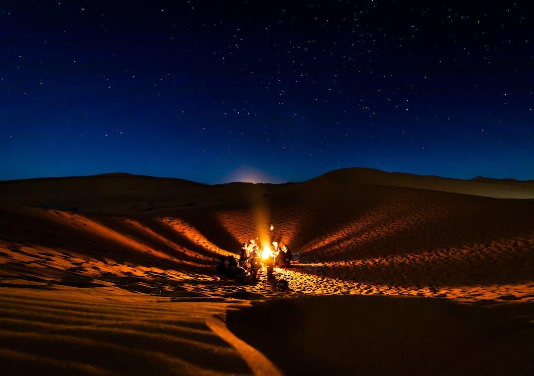 People Having Bonfire at Desert at Night