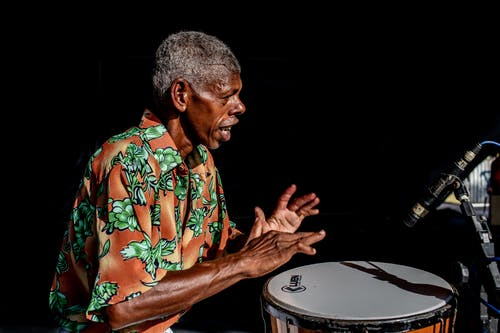 Man Playing Percussion Instrument