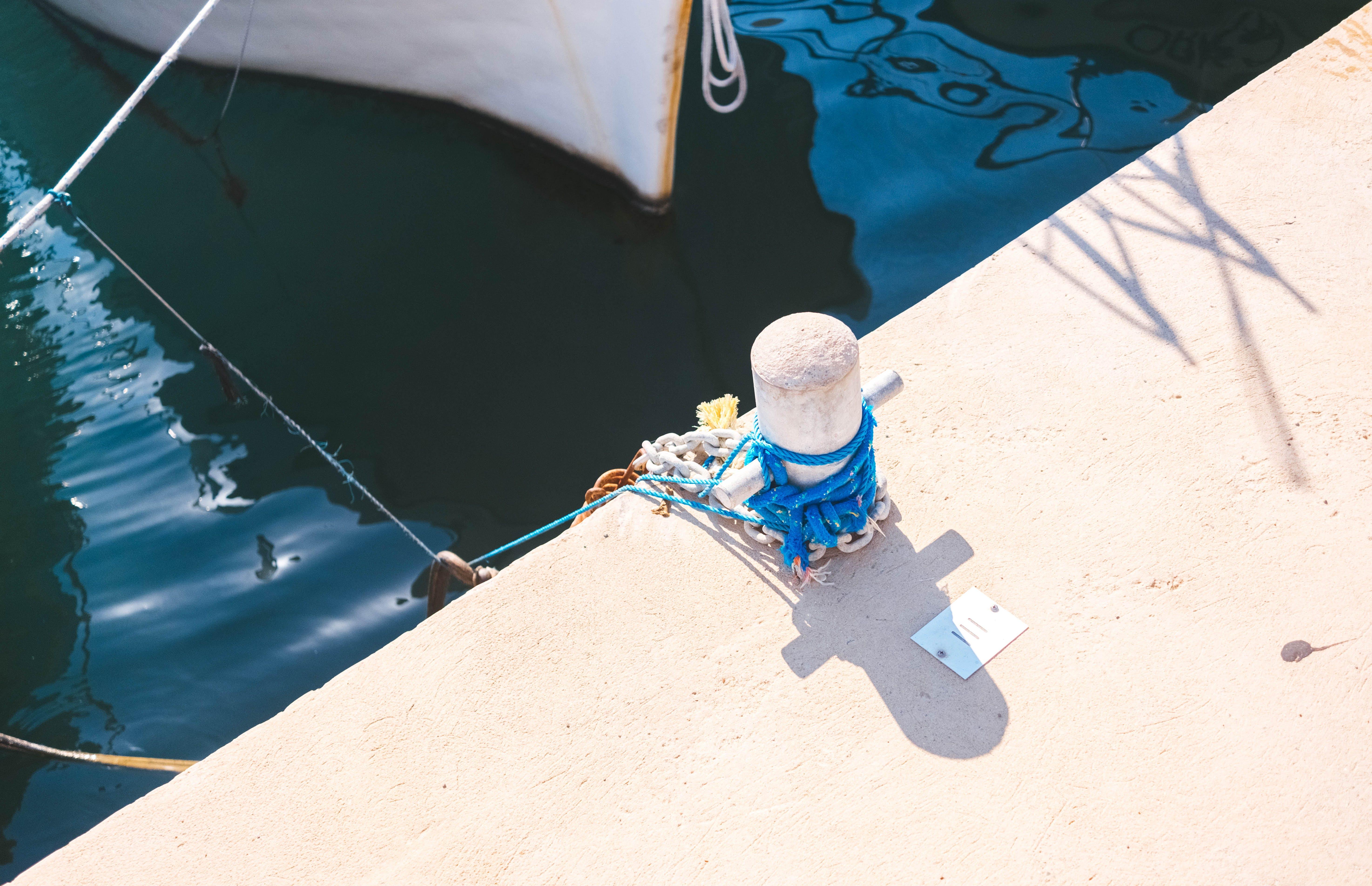 White Concrete Post Near Boat