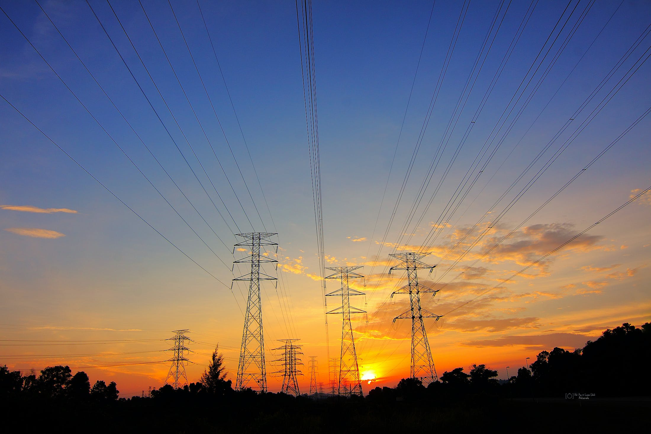 Grey Transmission Towers at Golden Hour