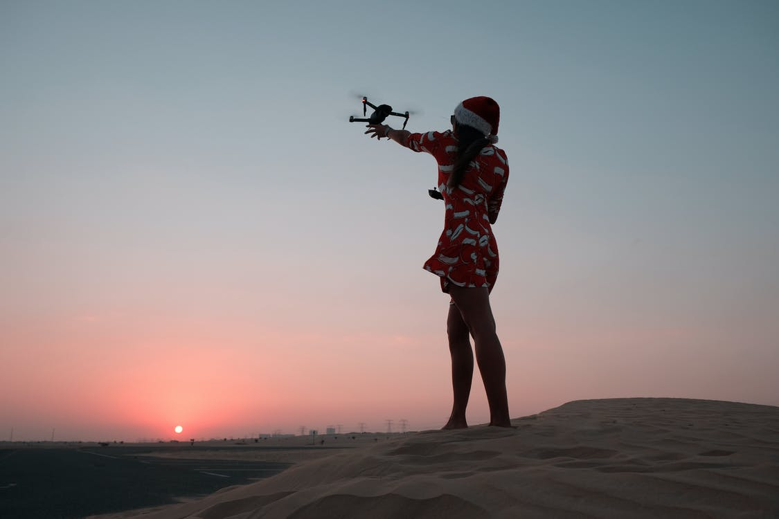 Photo of Woman Holding Quadcopter