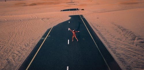 Woman Standing Between Road