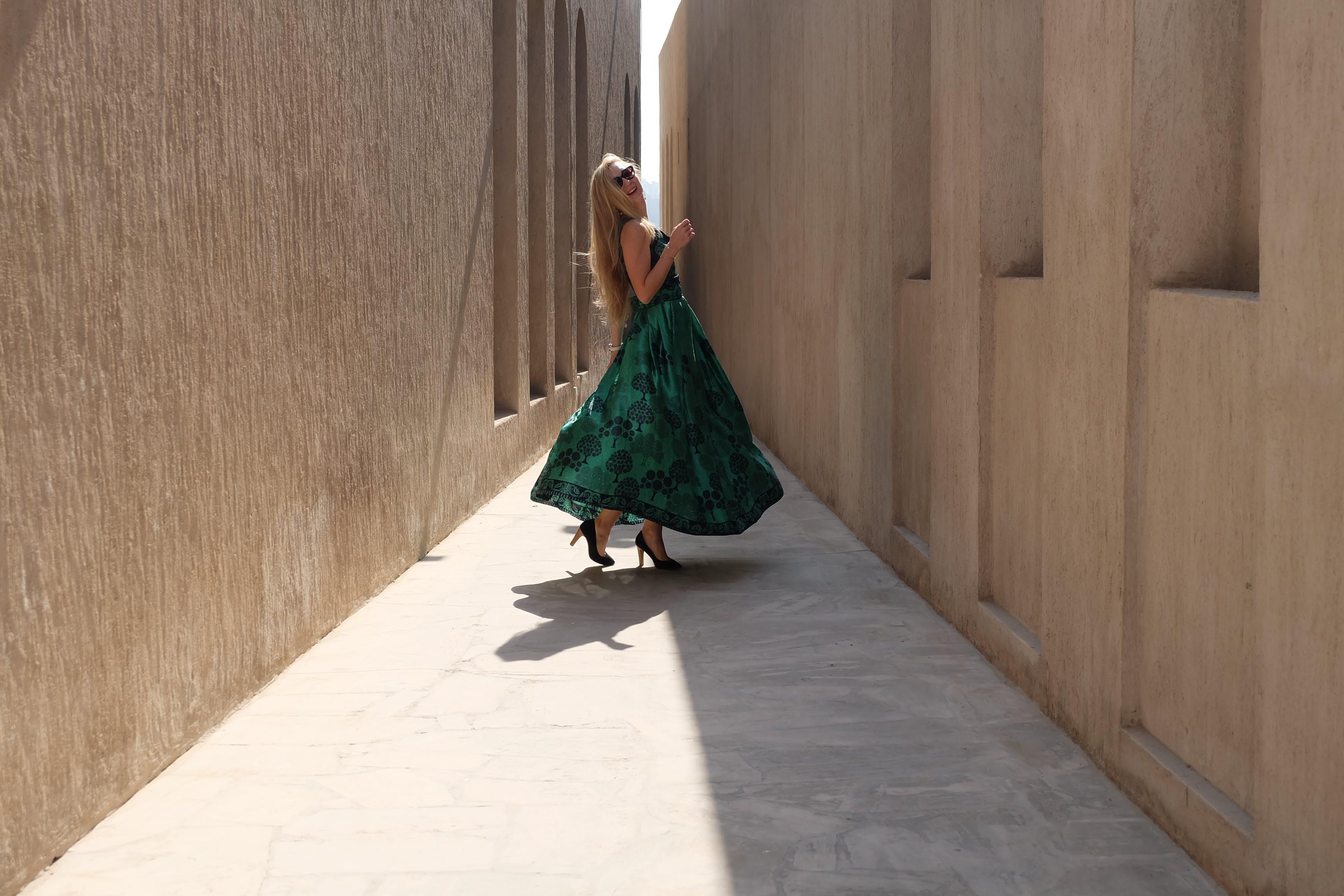 Photo of Woman Wearing Green Dress