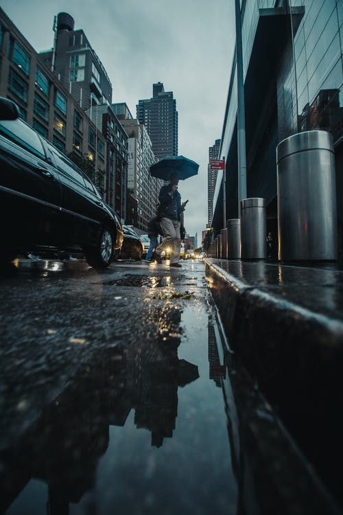 Low Angle Photography of Person Holding Umbrella
