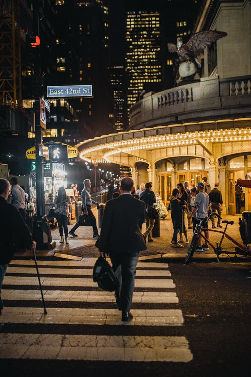 Man Walking on Pedestrian Lane at Night