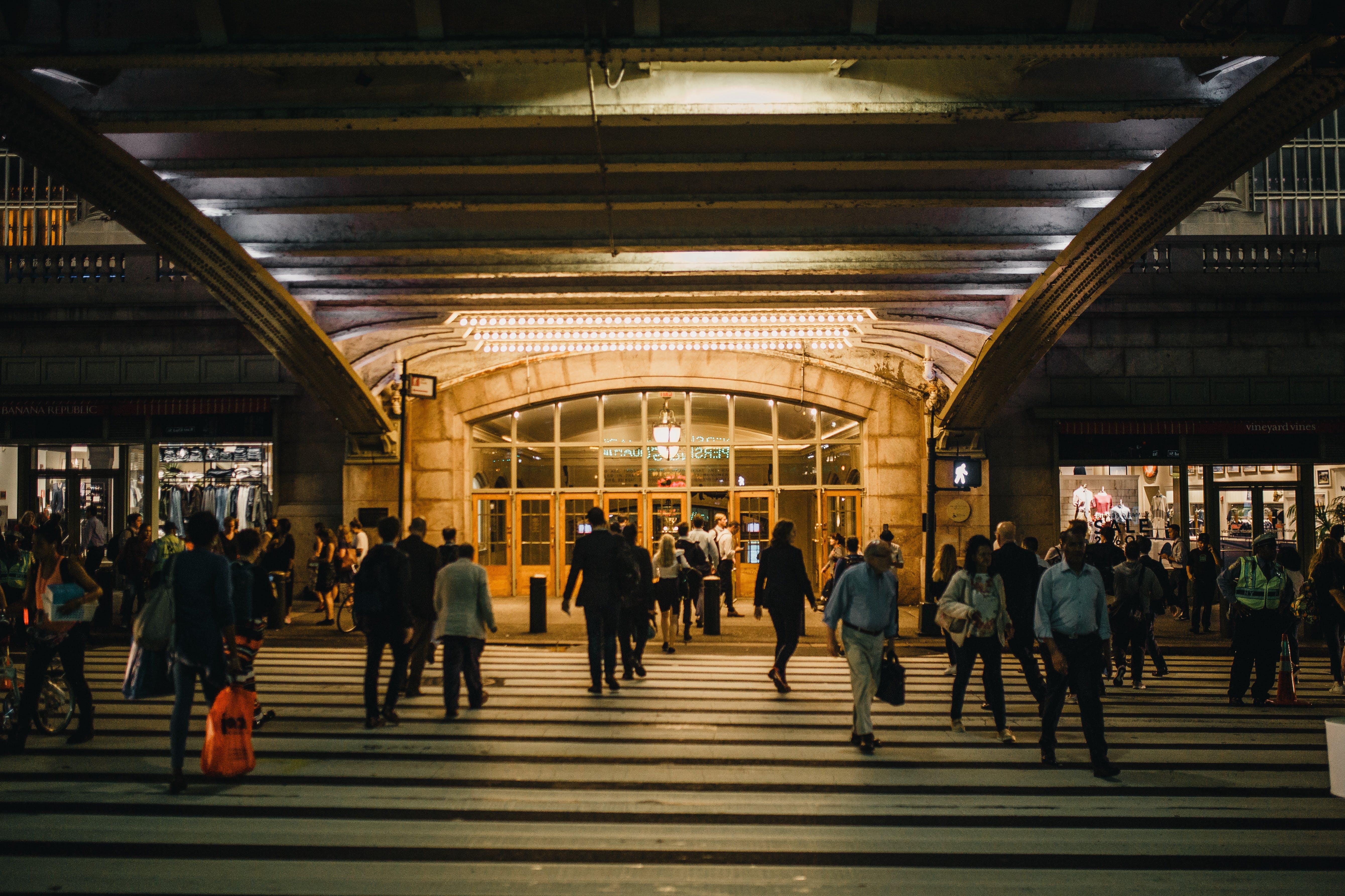 People Walking Near Building at Night