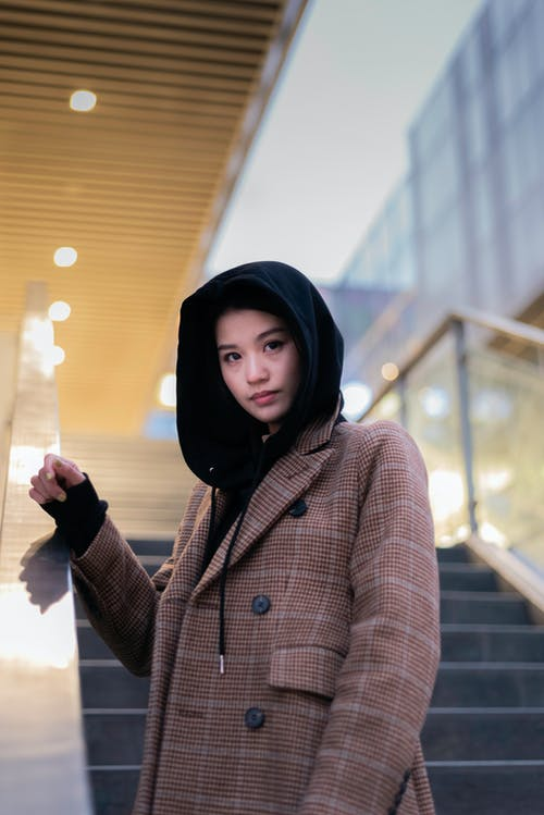 Shallow Focus Photography Of Woman In Winter Coat