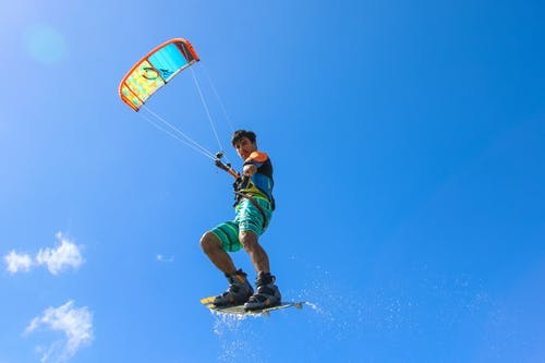 Photo of Pointing Man Kitesurfing