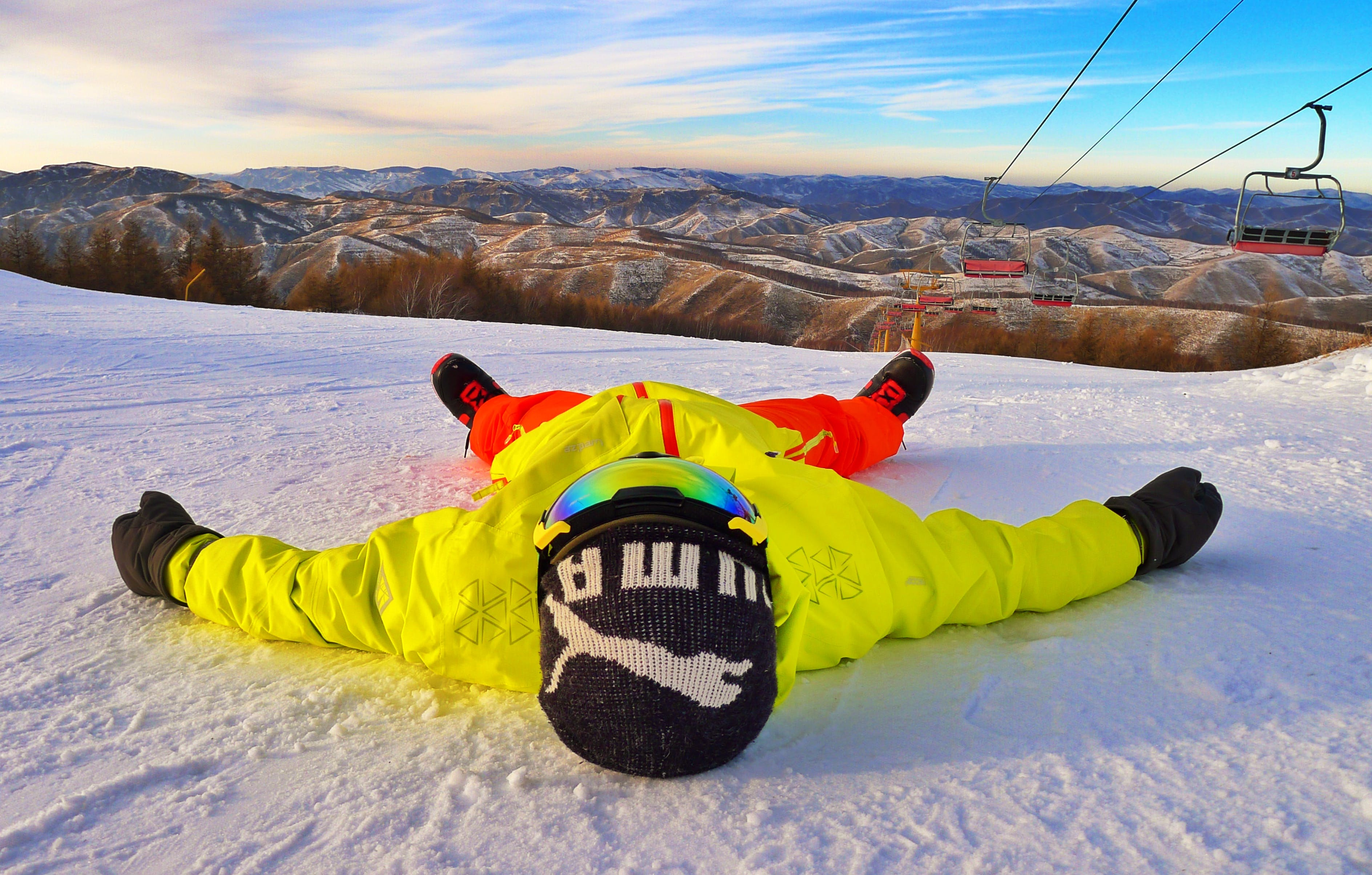 Person Lying on Snow Ground