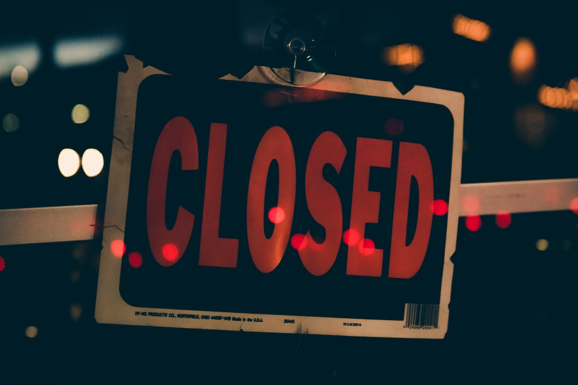 Close-Up Photo of Closed Signboard