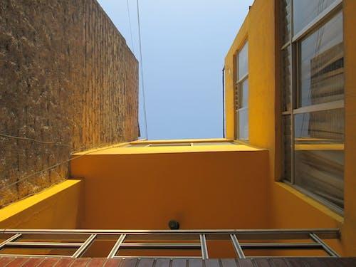 Gratis lagerfoto af gul væg, pareret amarilla