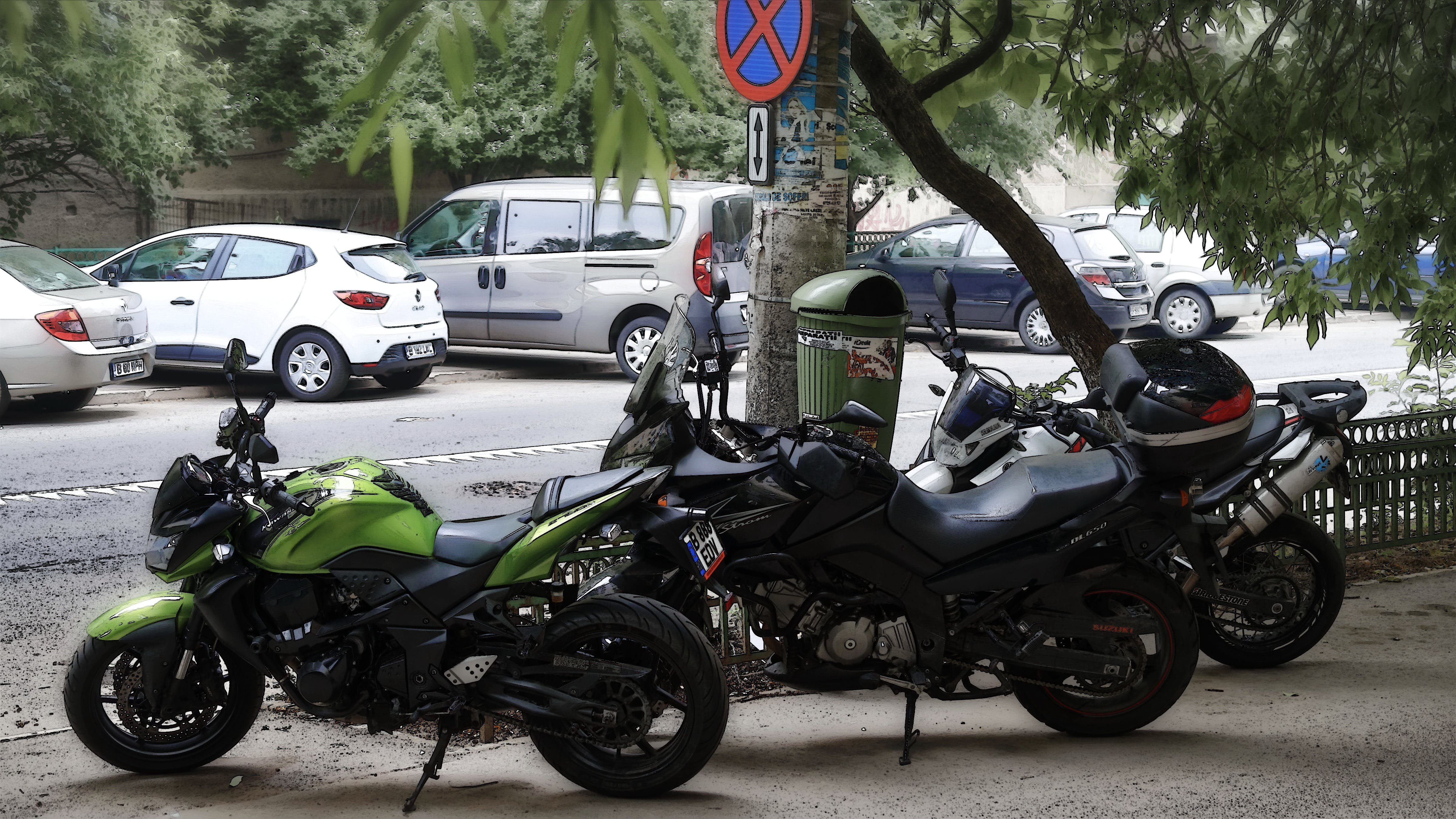 Free stock photo of metallic fence, motor bikes, parked, parked cars