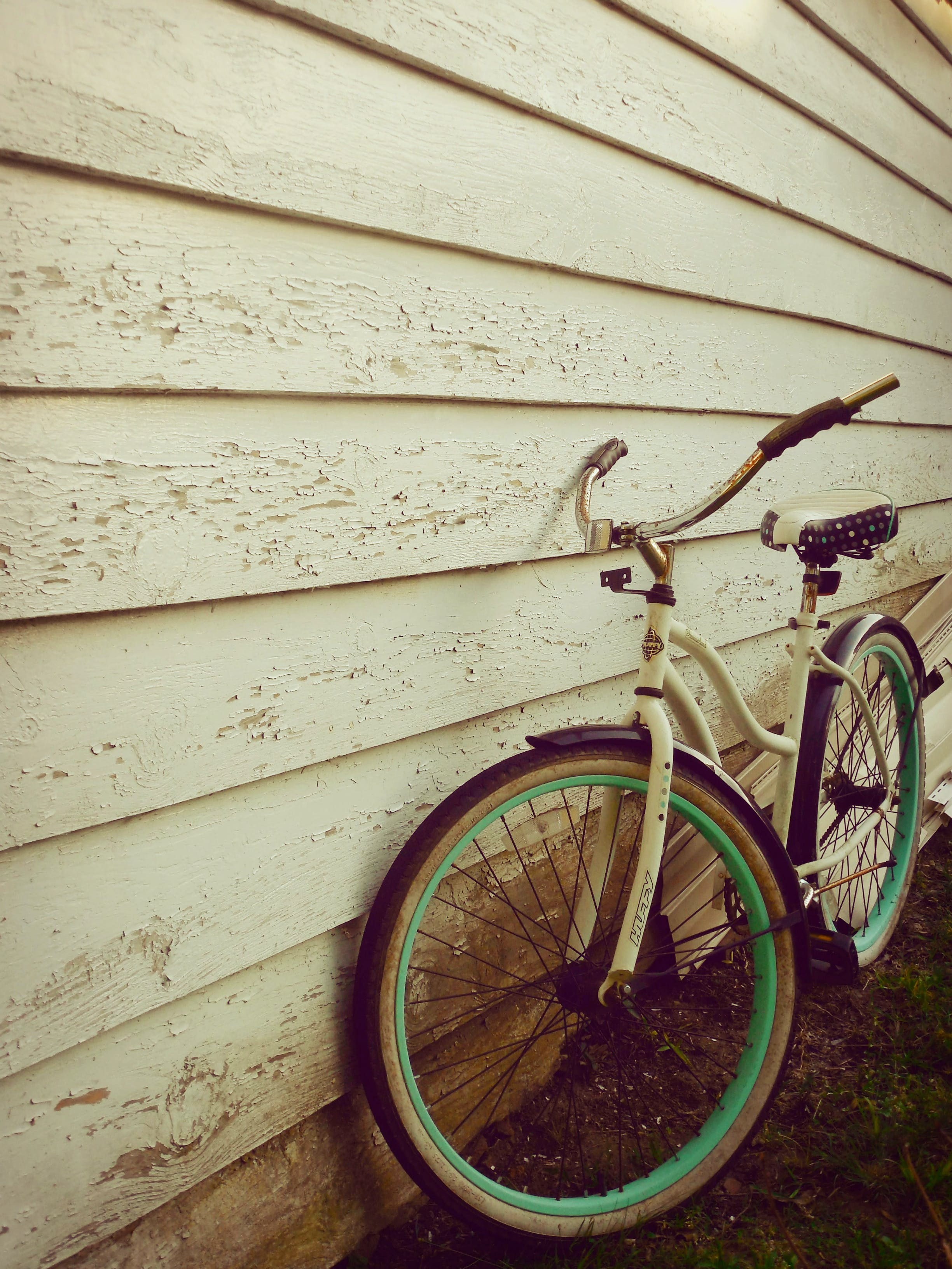 White and Teal Beach Cruiser Bike Beside White Painted Wooden Wall