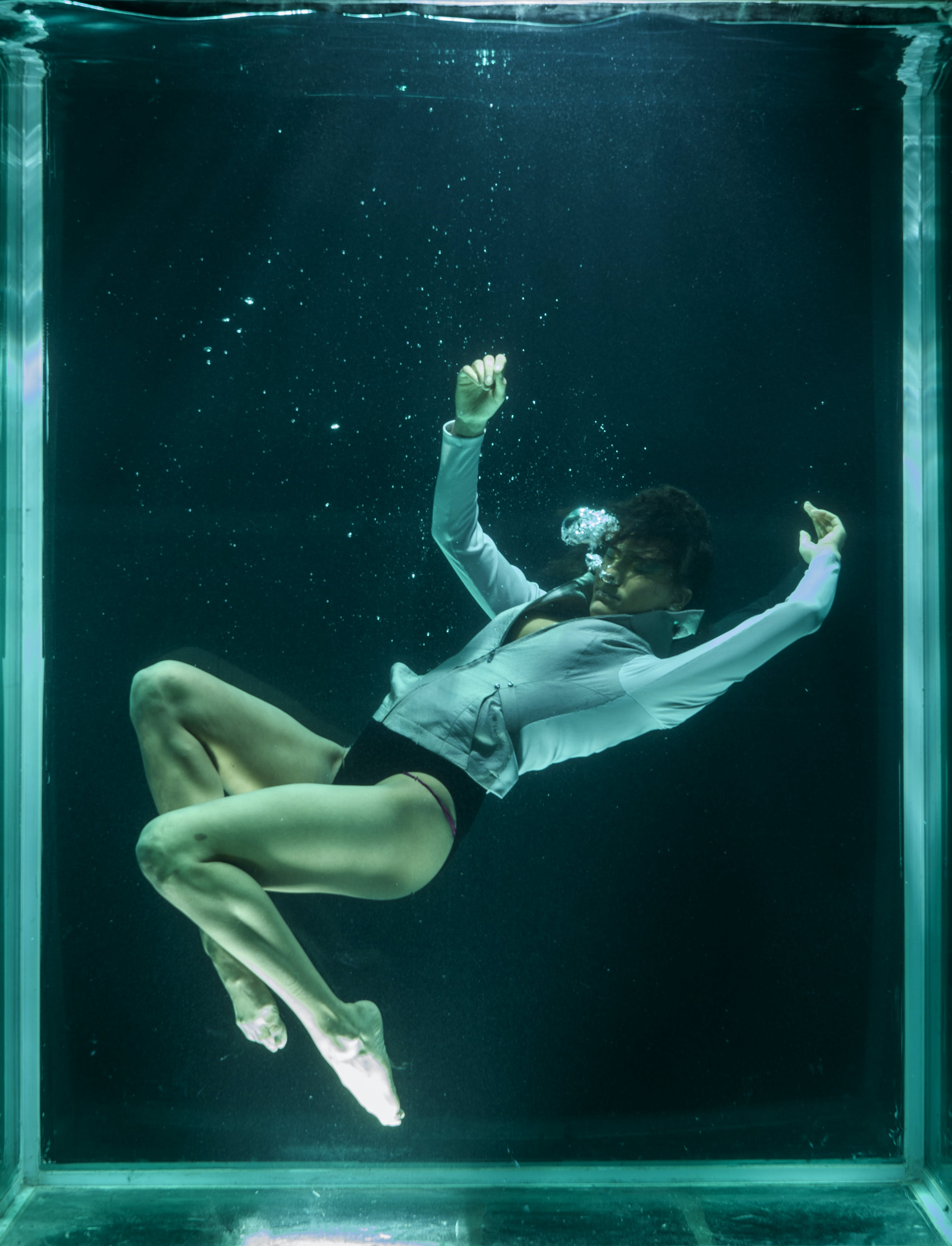 Person Wearing White Long-sleeved Shirt in Underwater