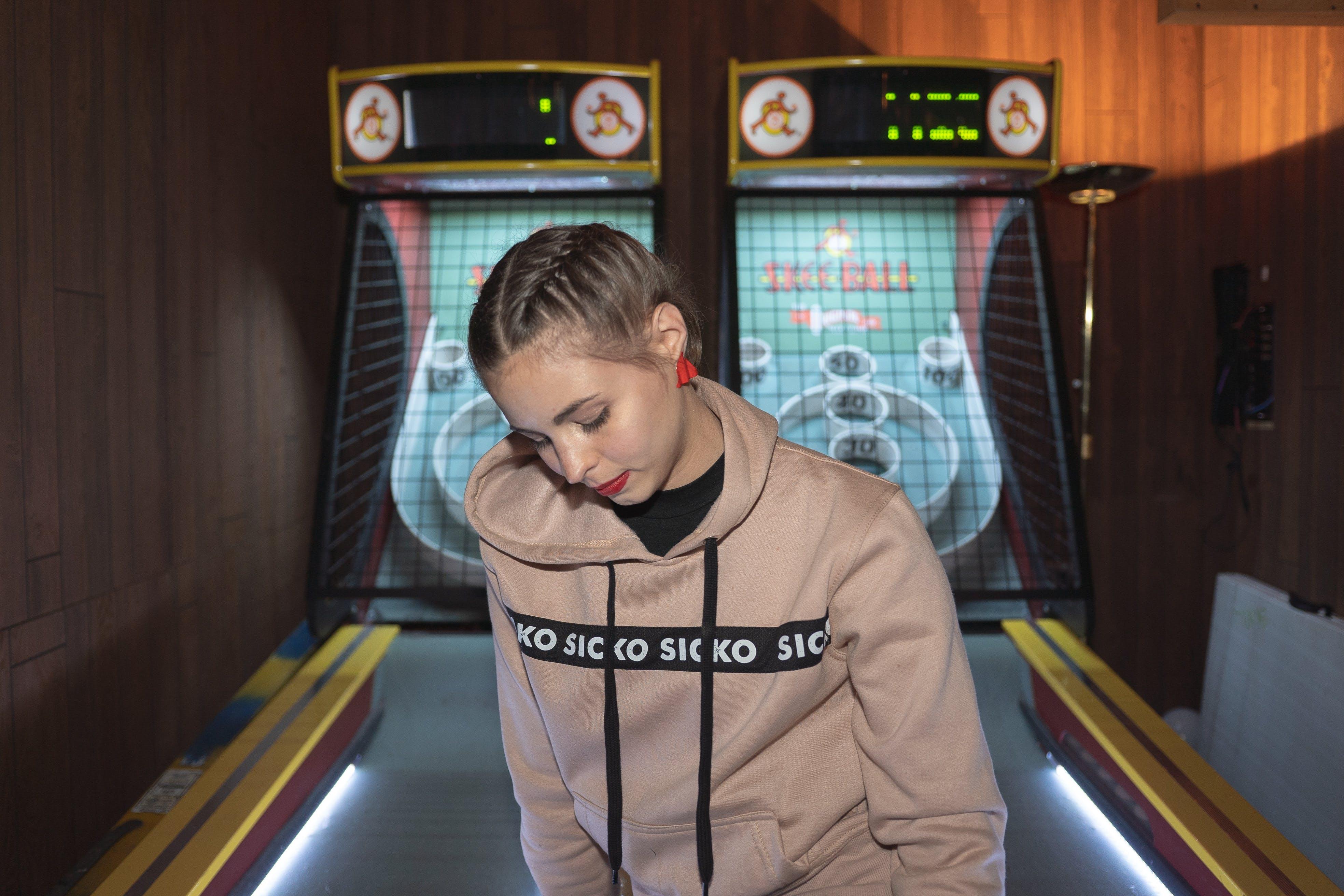 Woman Near Maze Arcade Machine