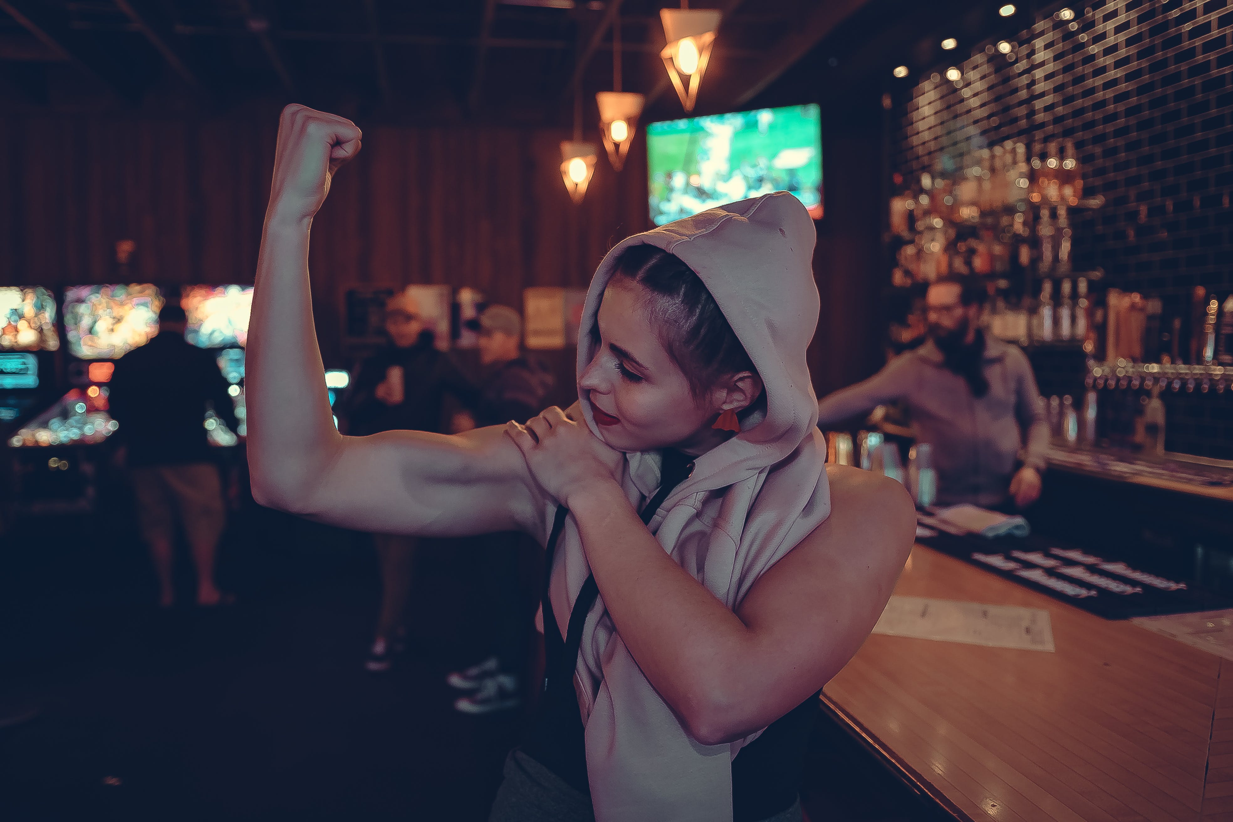 Woman Showing Biceps in Bar