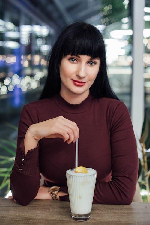 Woman Stirring Drink