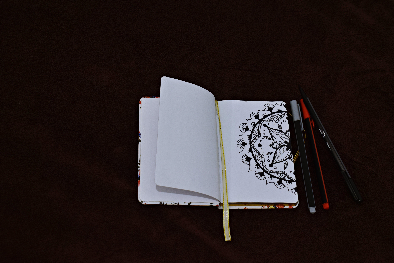 Notebook Beside Pen