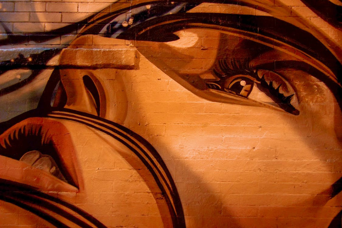 Human Face Painting On Wall