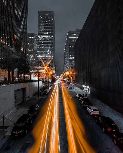 Photo of Light Streaks On Road During Evening