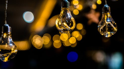 Close-Up Photo of Three Hanging Light Bulbs