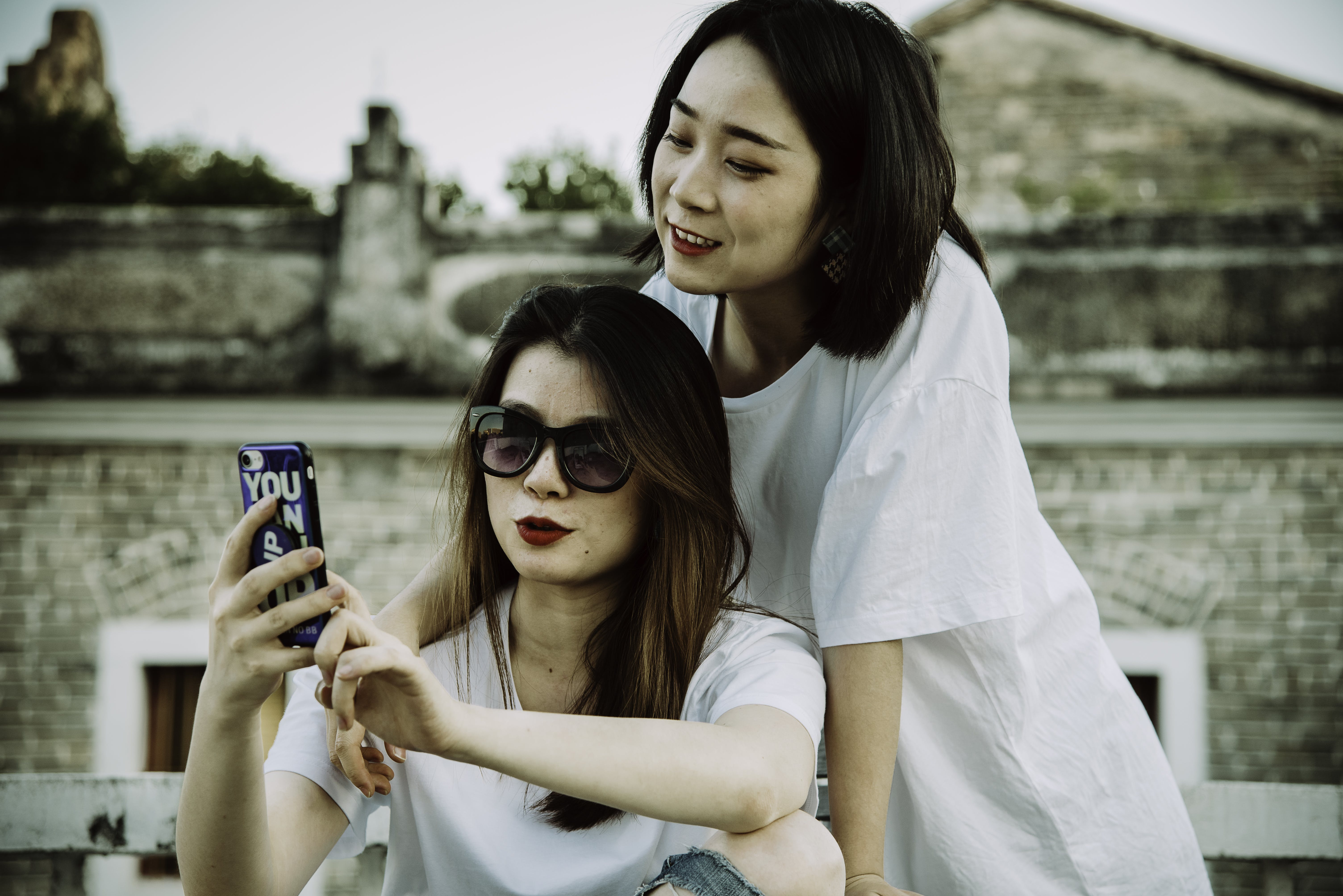 Photo of Women Looking At Mobile Phone