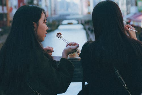 Photo of Two Women Eating