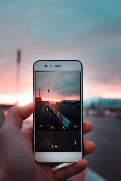 White Android Smartphone Capturing Road