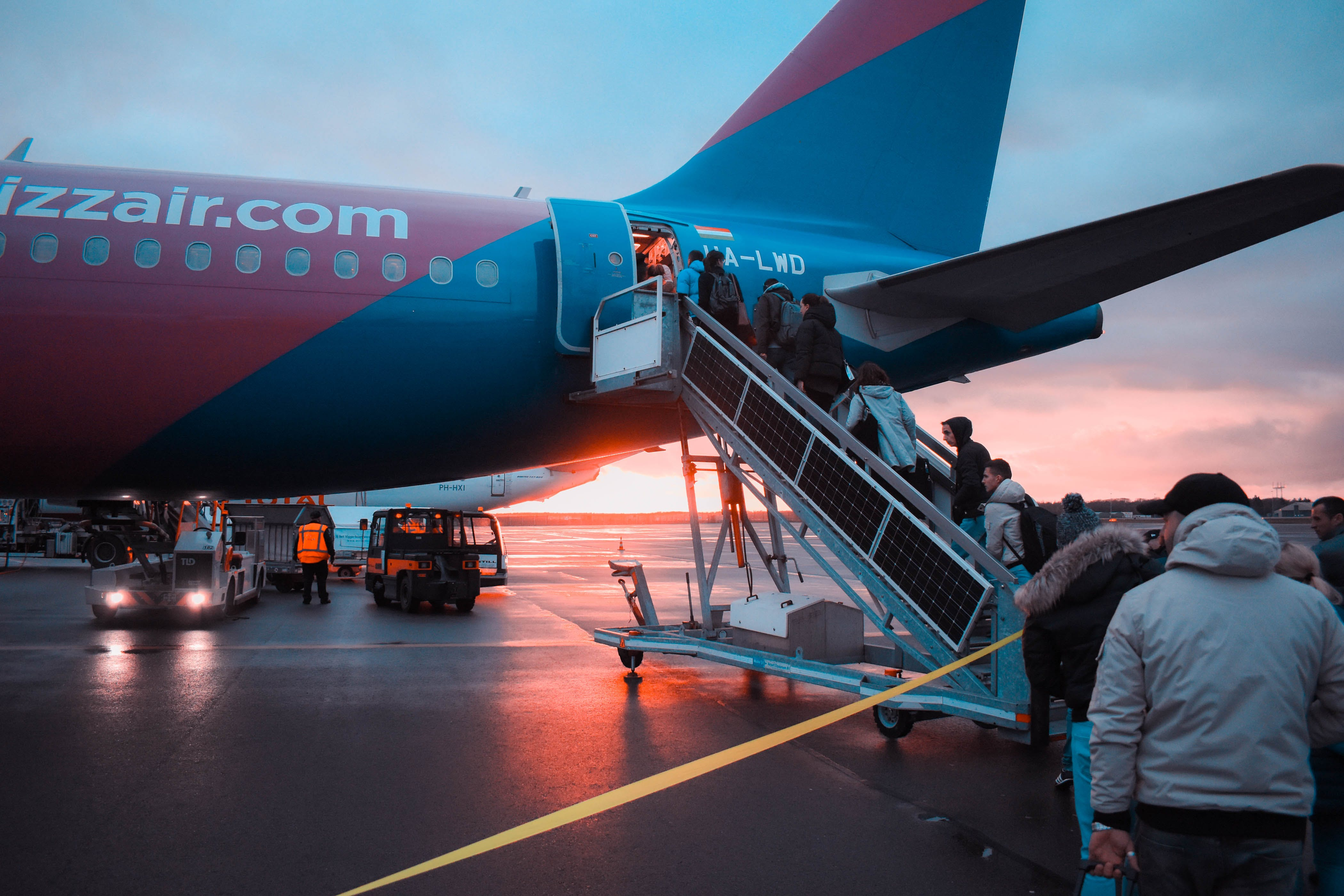 Photo of People Boarding Airliner
