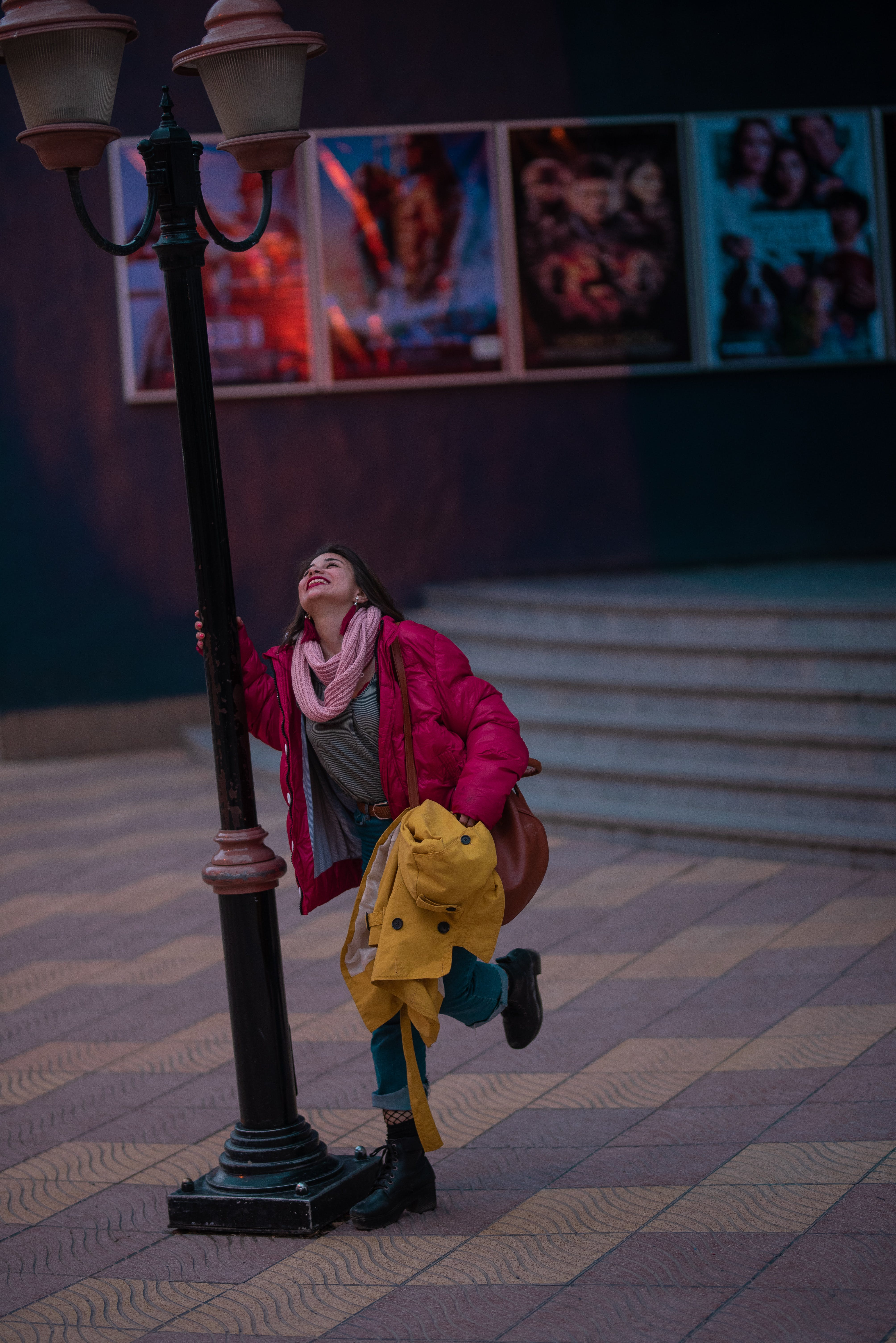 Woman Holding On Lamp Post