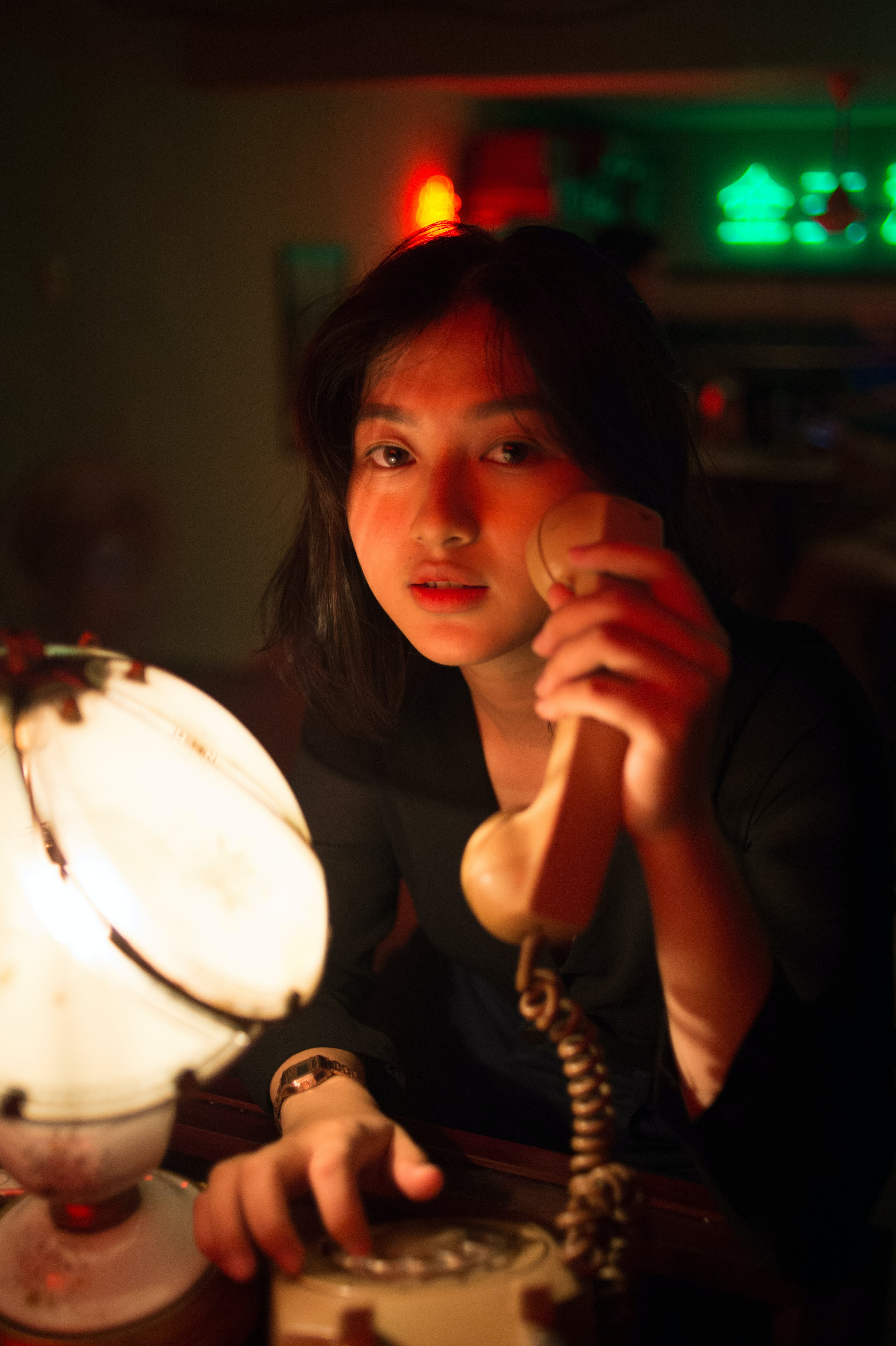 Close-Up Photo of Woman Holding Telephone
