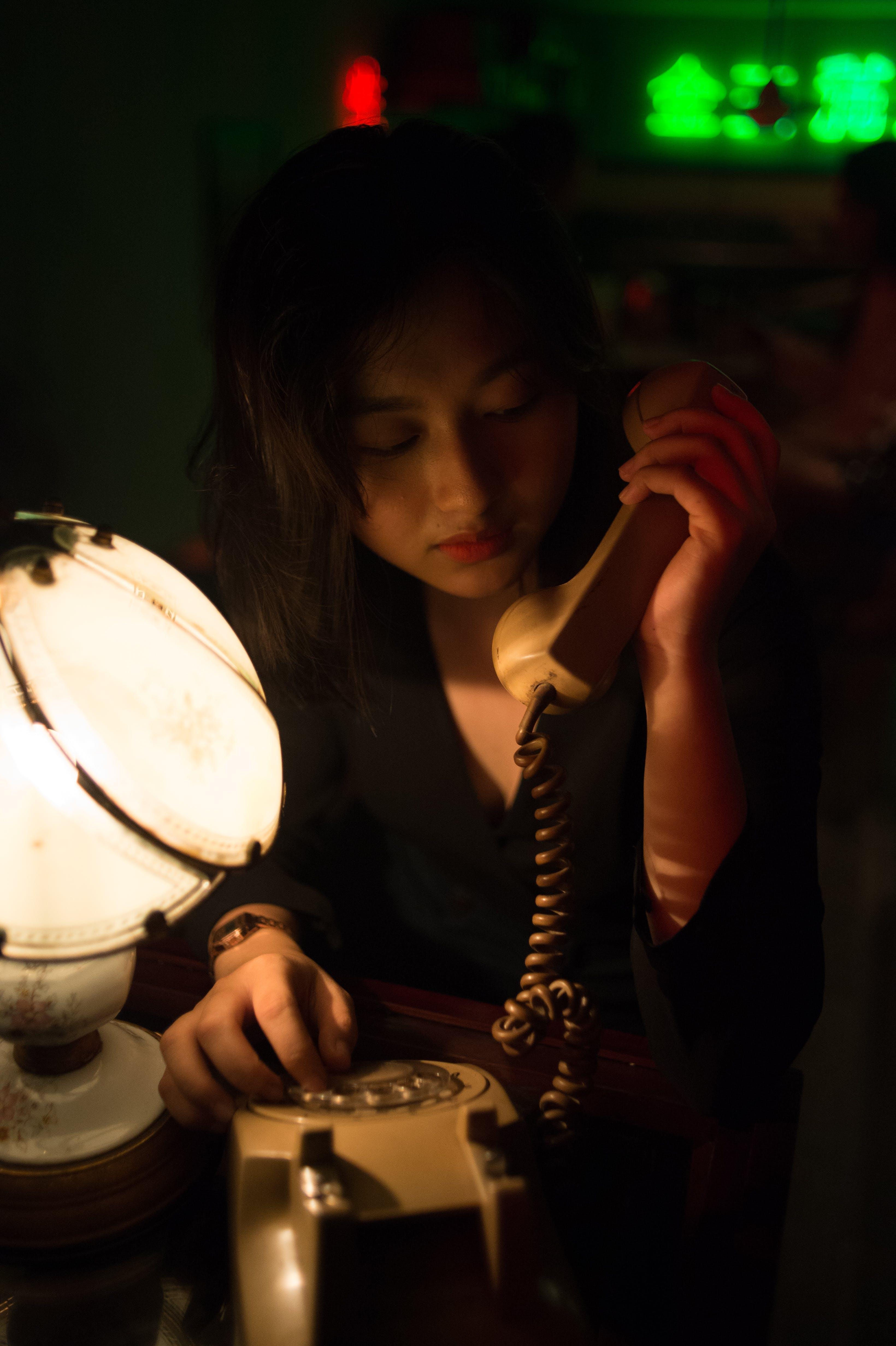 Woman Holding Telephone