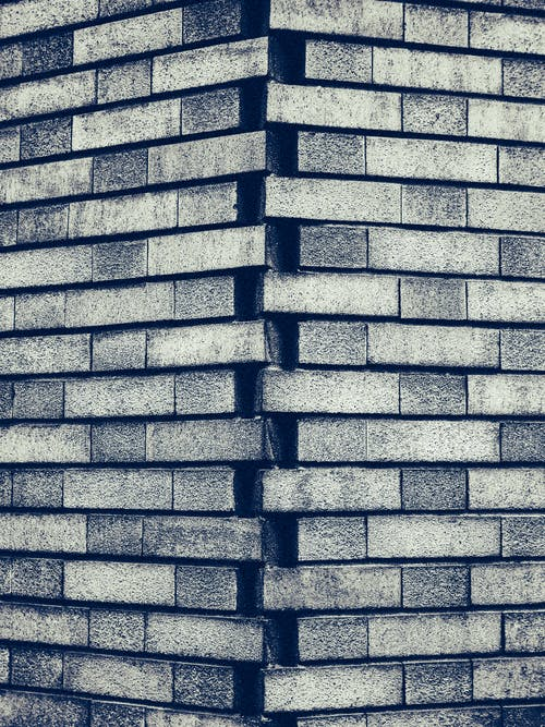 Grayscale Photography of Gray Brick Wall