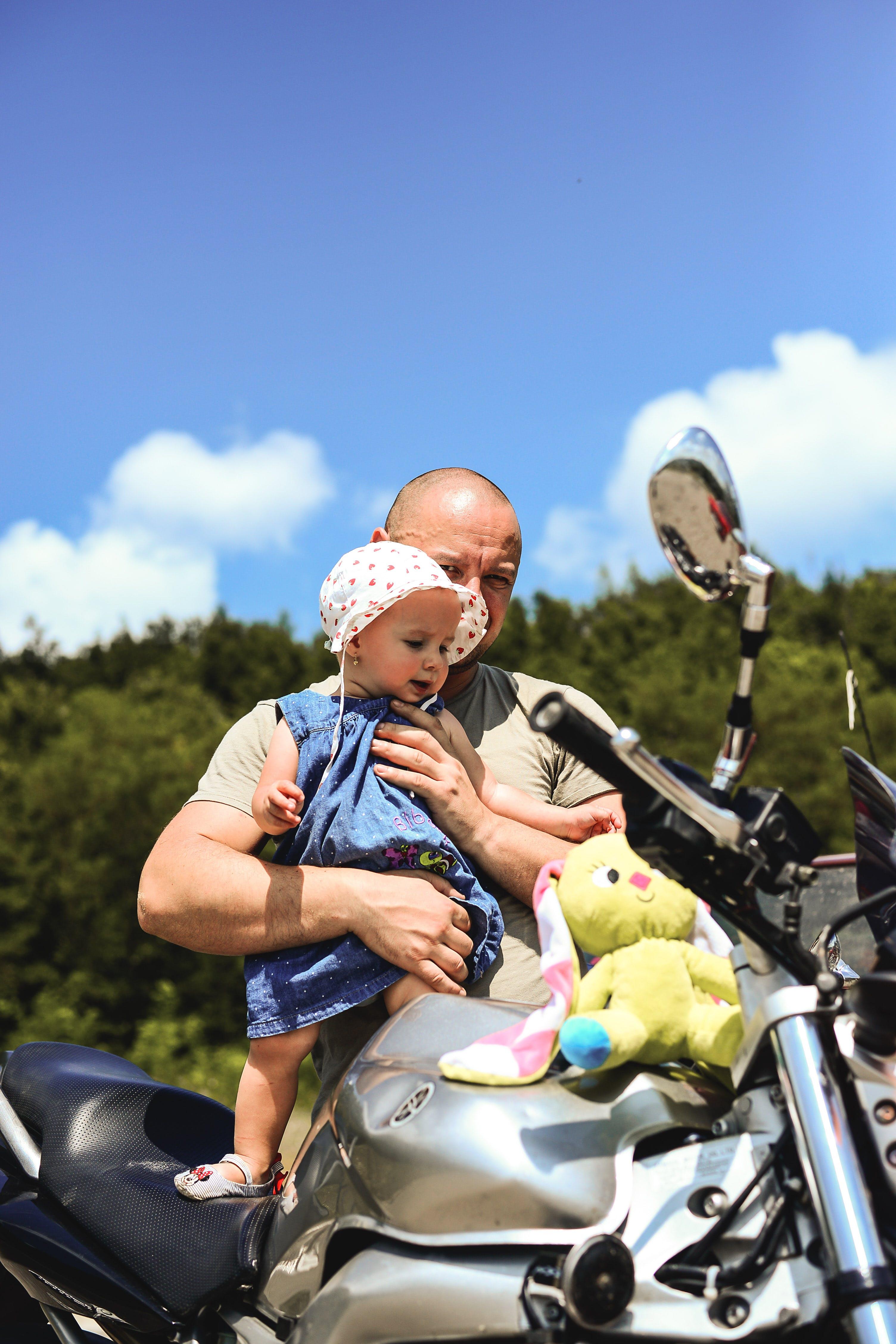 Man Holding Toddler
