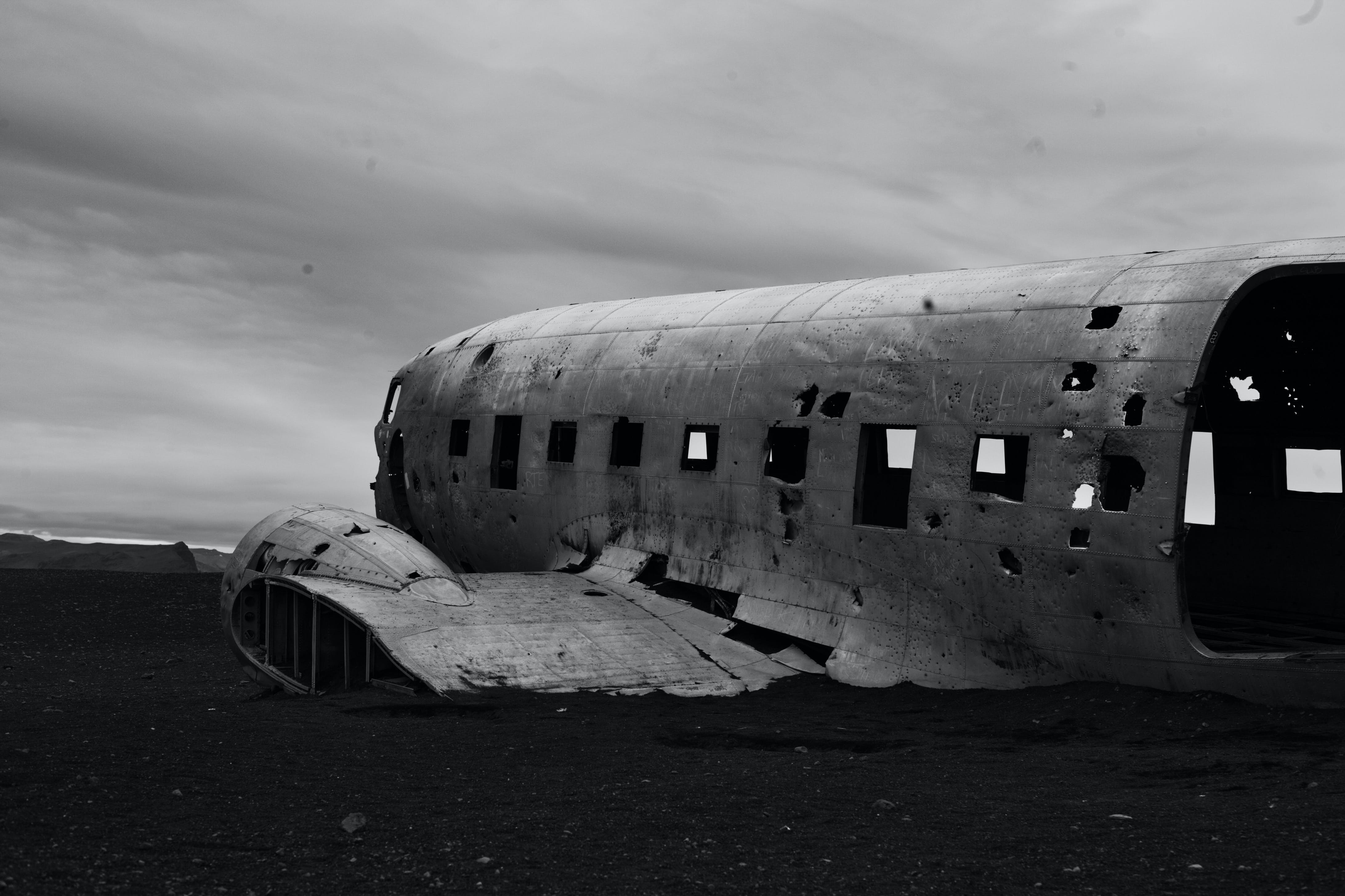 Wrecked Plane on Ground Grayscale Photography