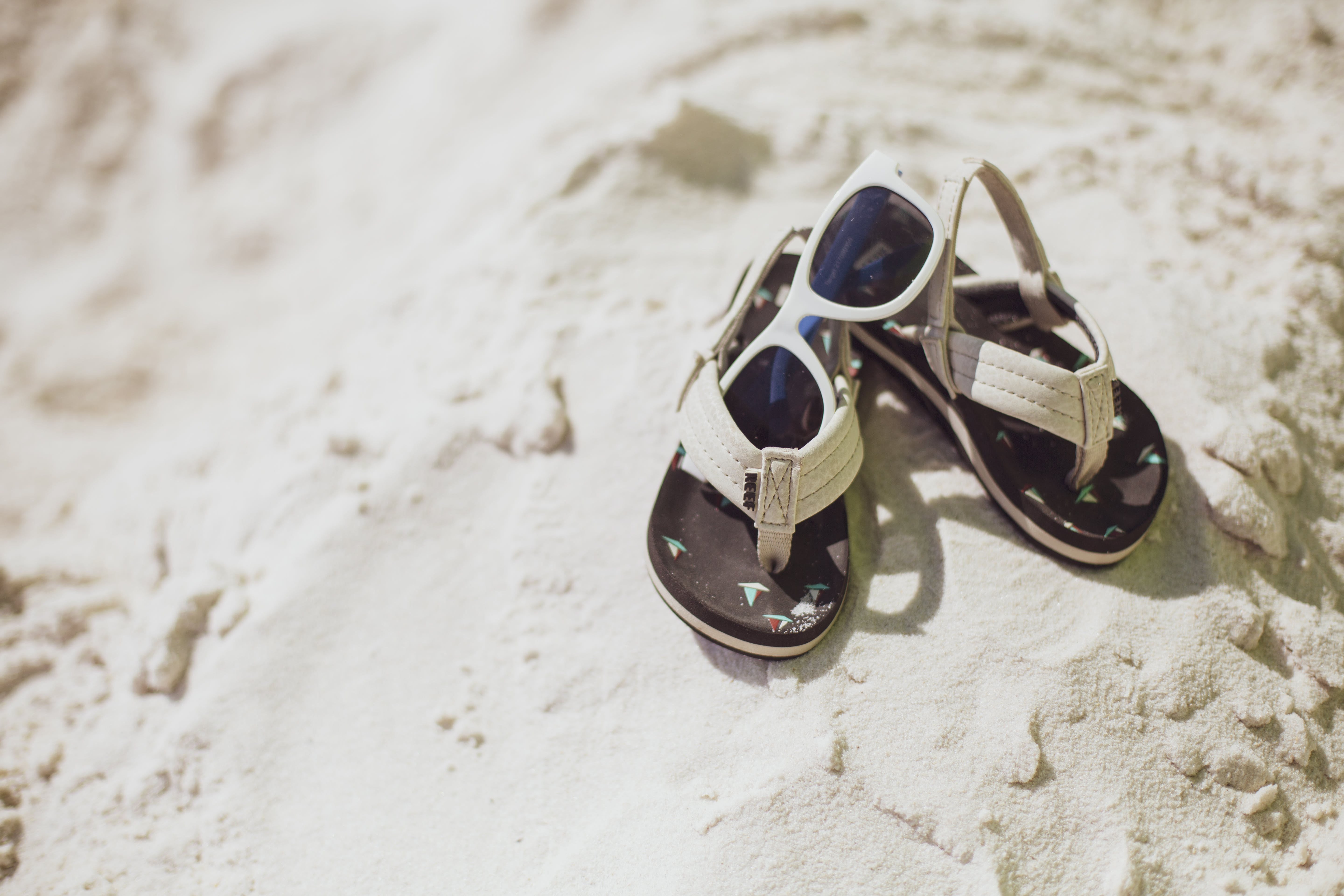 Free stock photo of baby shoes, beach, sand