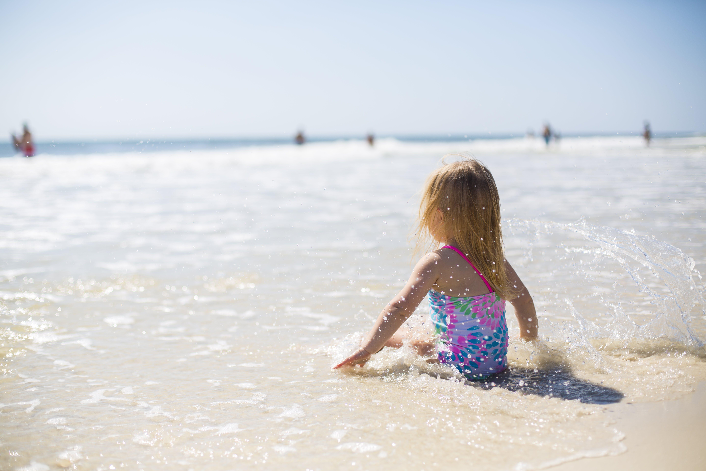 Girl Sitting on Shore