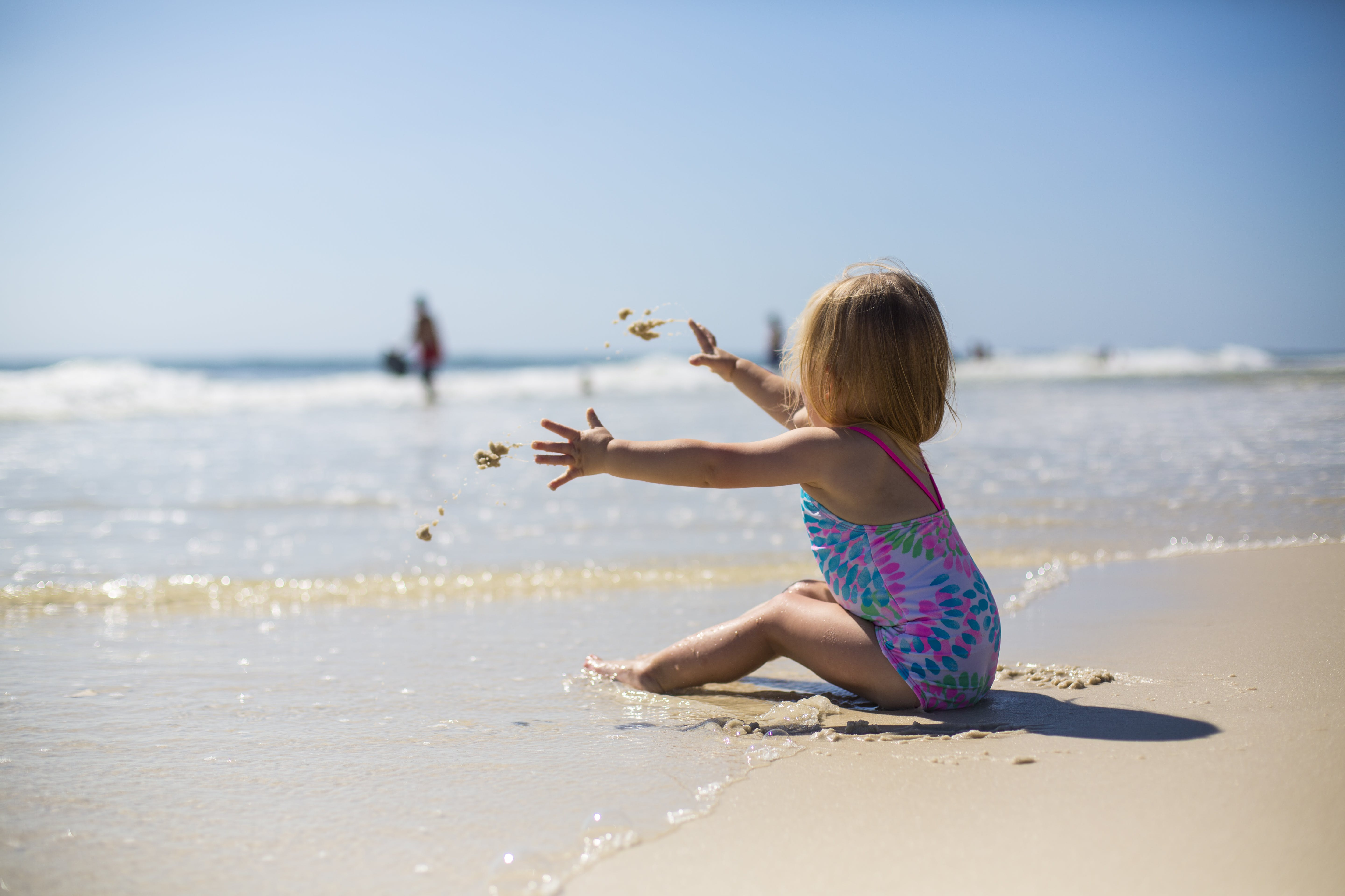 Toddler Girl Sitting on Shore during Day