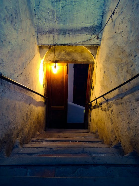 Brown Wooden Door Near Concrete Stairs With Light