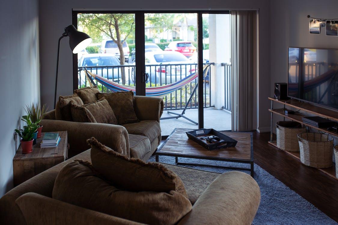 Turned-off Flat Screen Tv Near Sofa Set Inside White Room