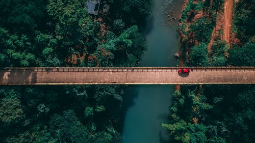 Aerial Photo Of Red Car On Bridge