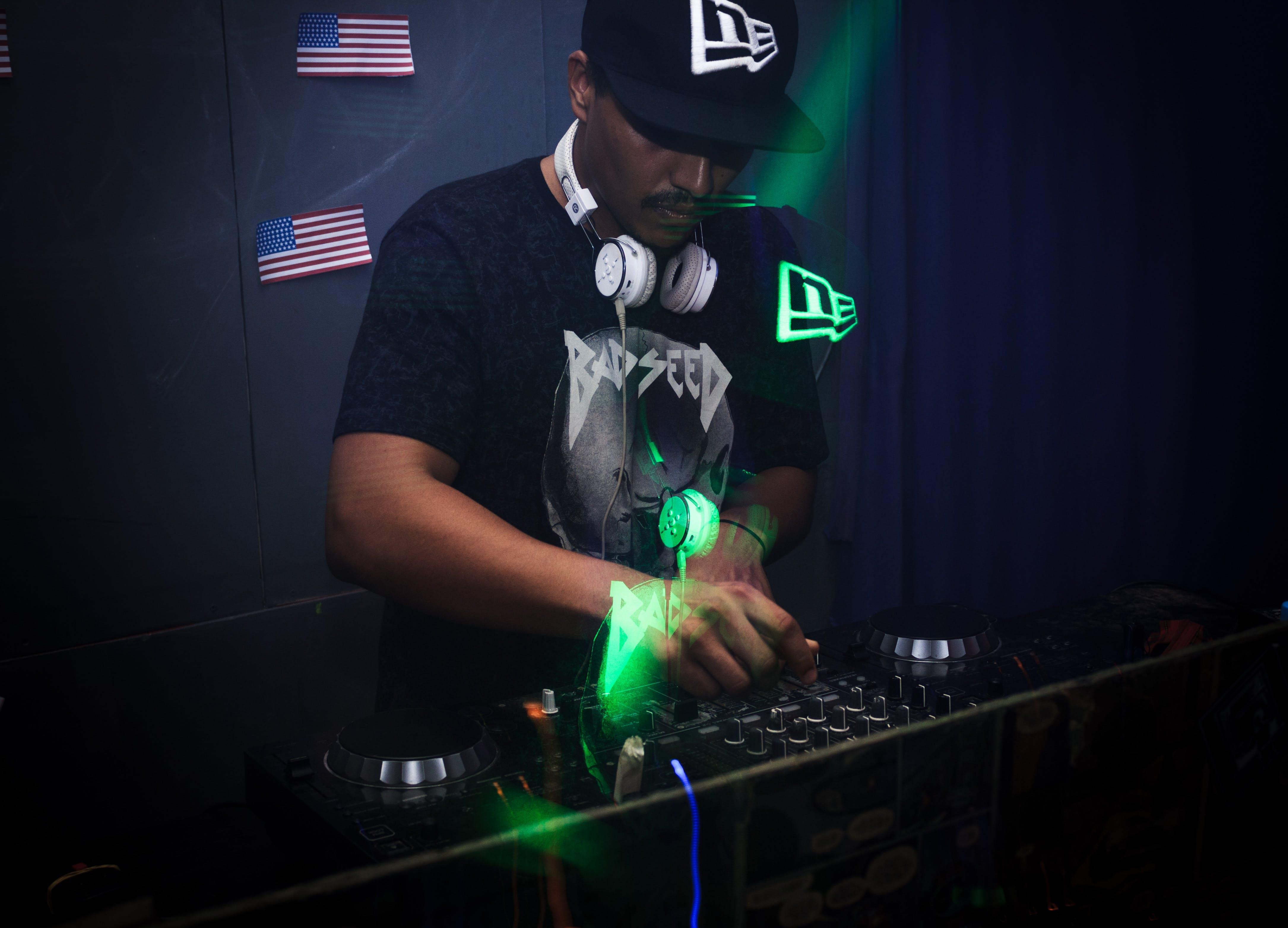 Photo of Man Playing DJ Mixer