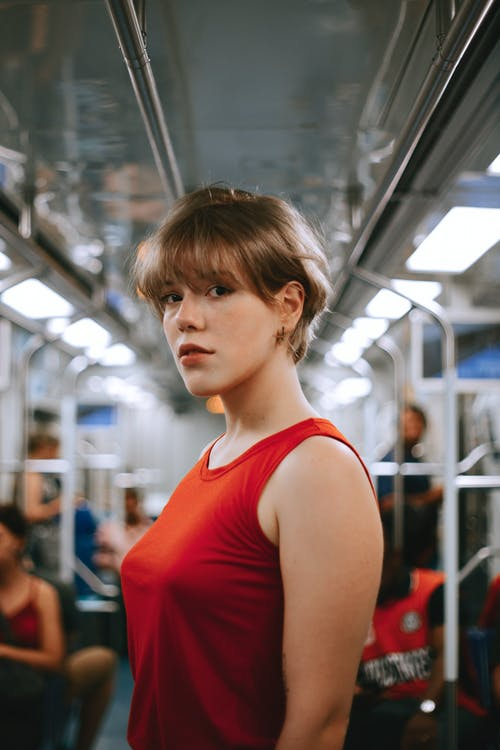 Woman In Red Tank Top Standing Inside Train
