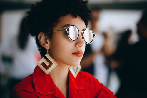 Woman in Silver Framed Eyeglasses and Red Top