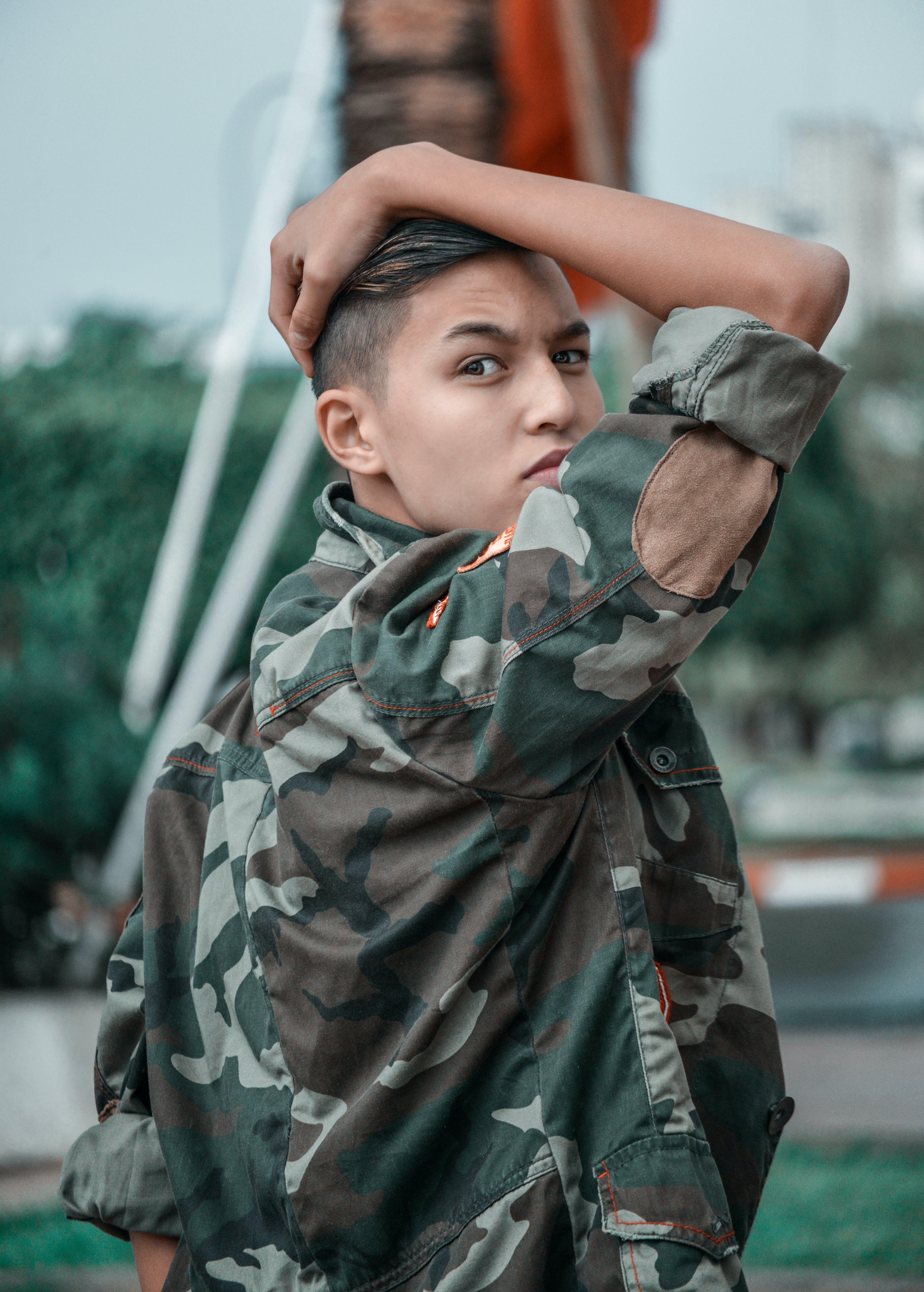 Photo of Boy Wearing Camouflage Jacket