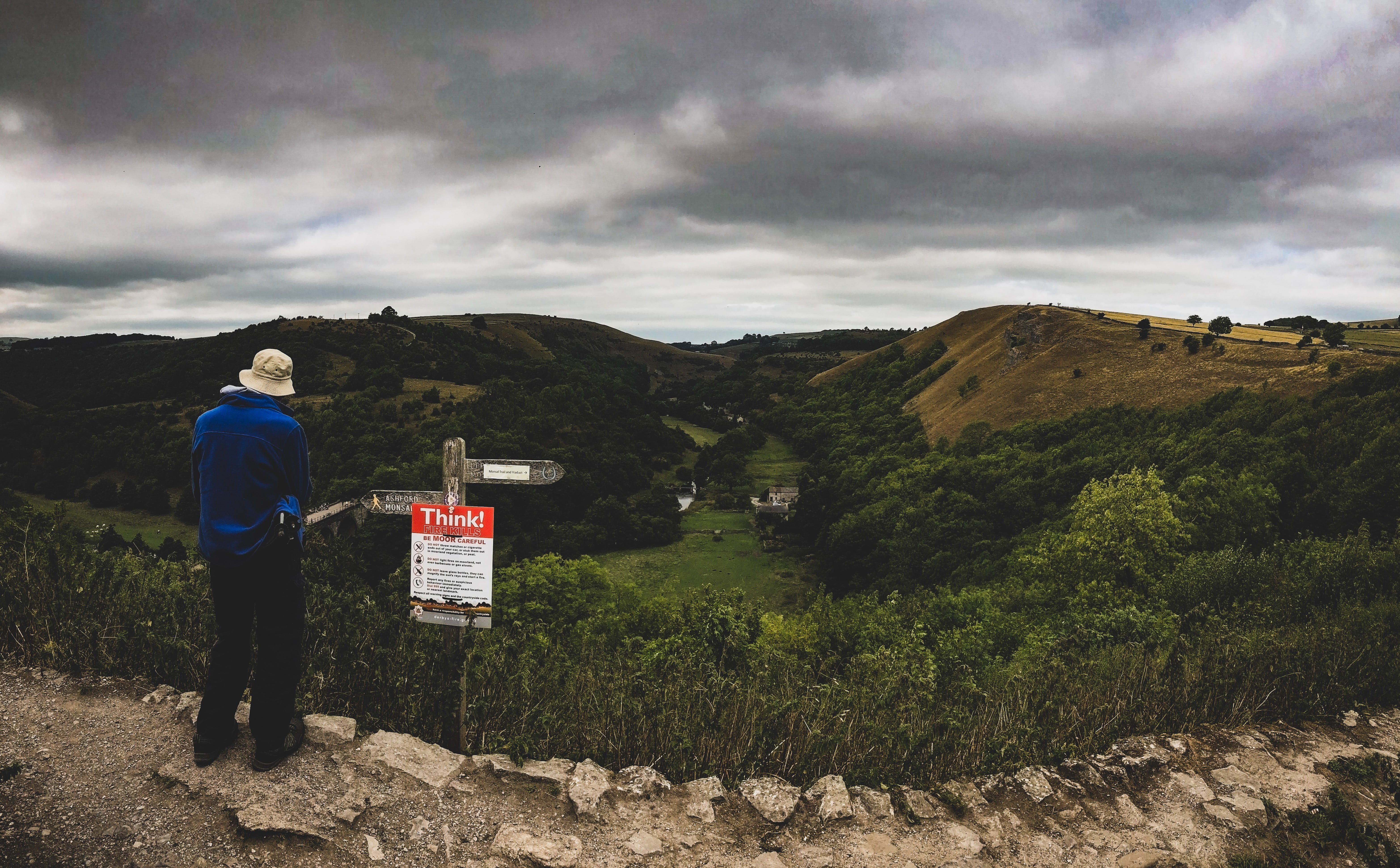 Person in Blue Top Staring At Hills