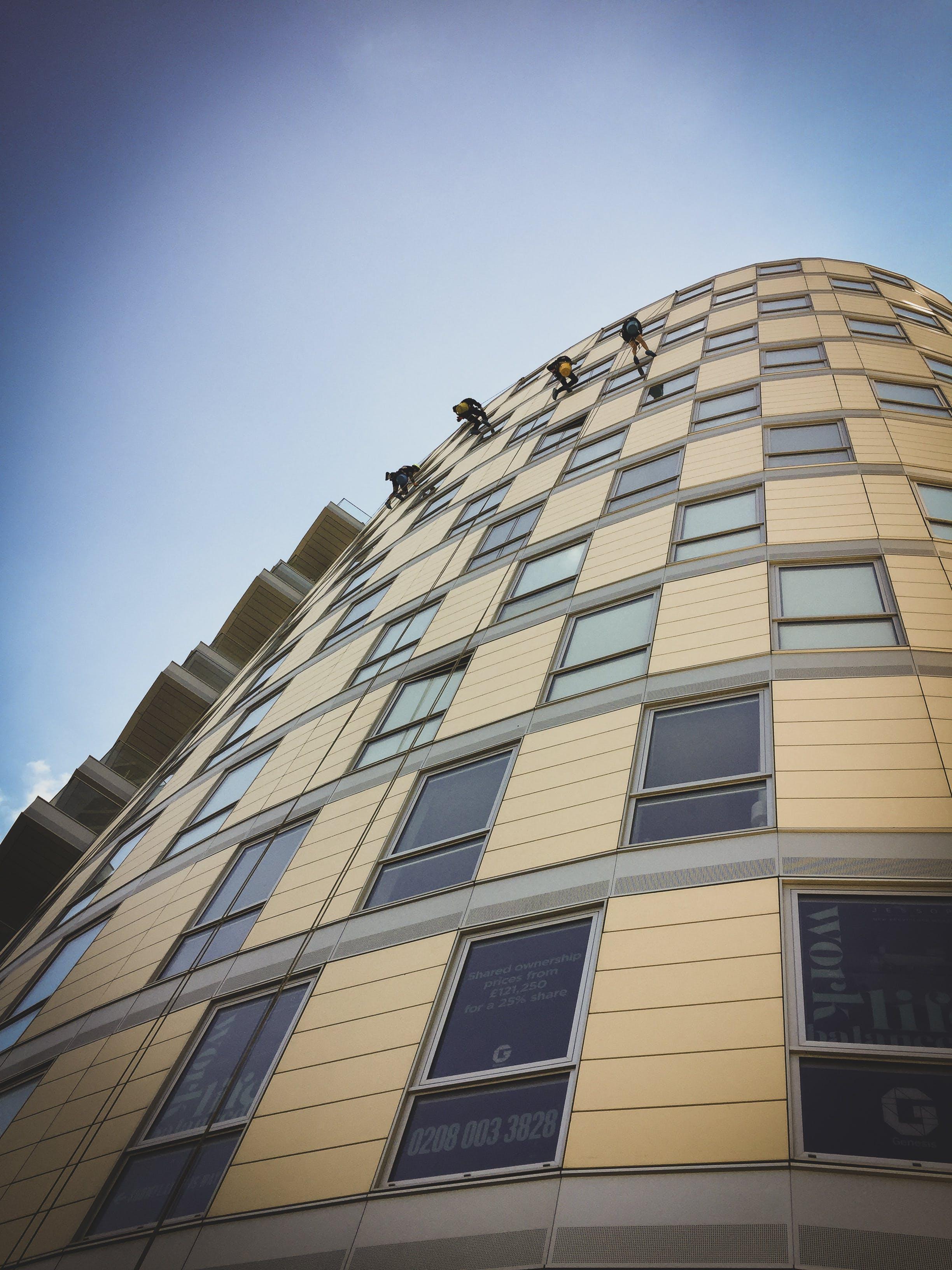 Beige High Rise Building Under Blue Sky